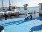 Обработка палубы судна и подземный резервуар, фото